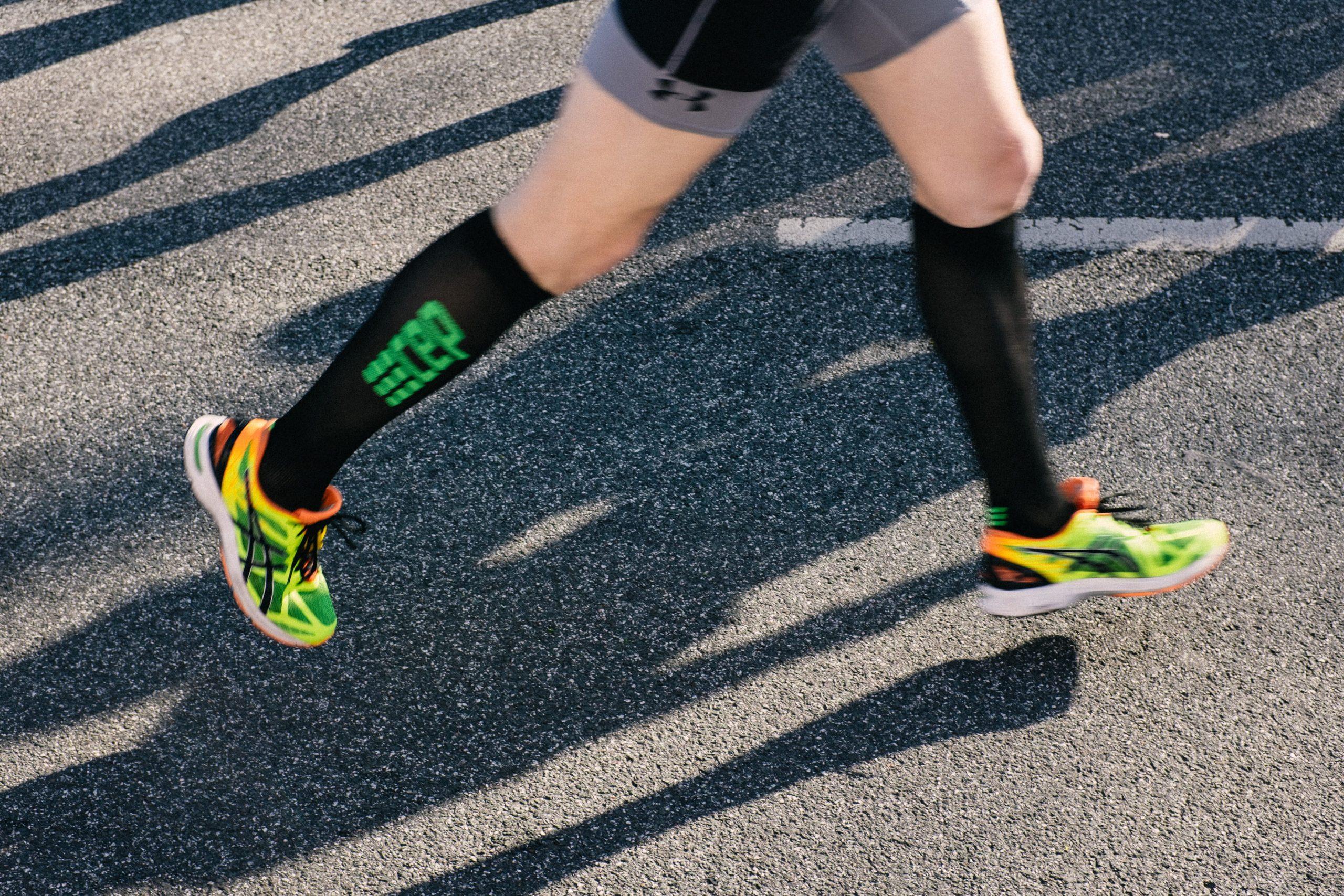 Marathon runner with compression socks