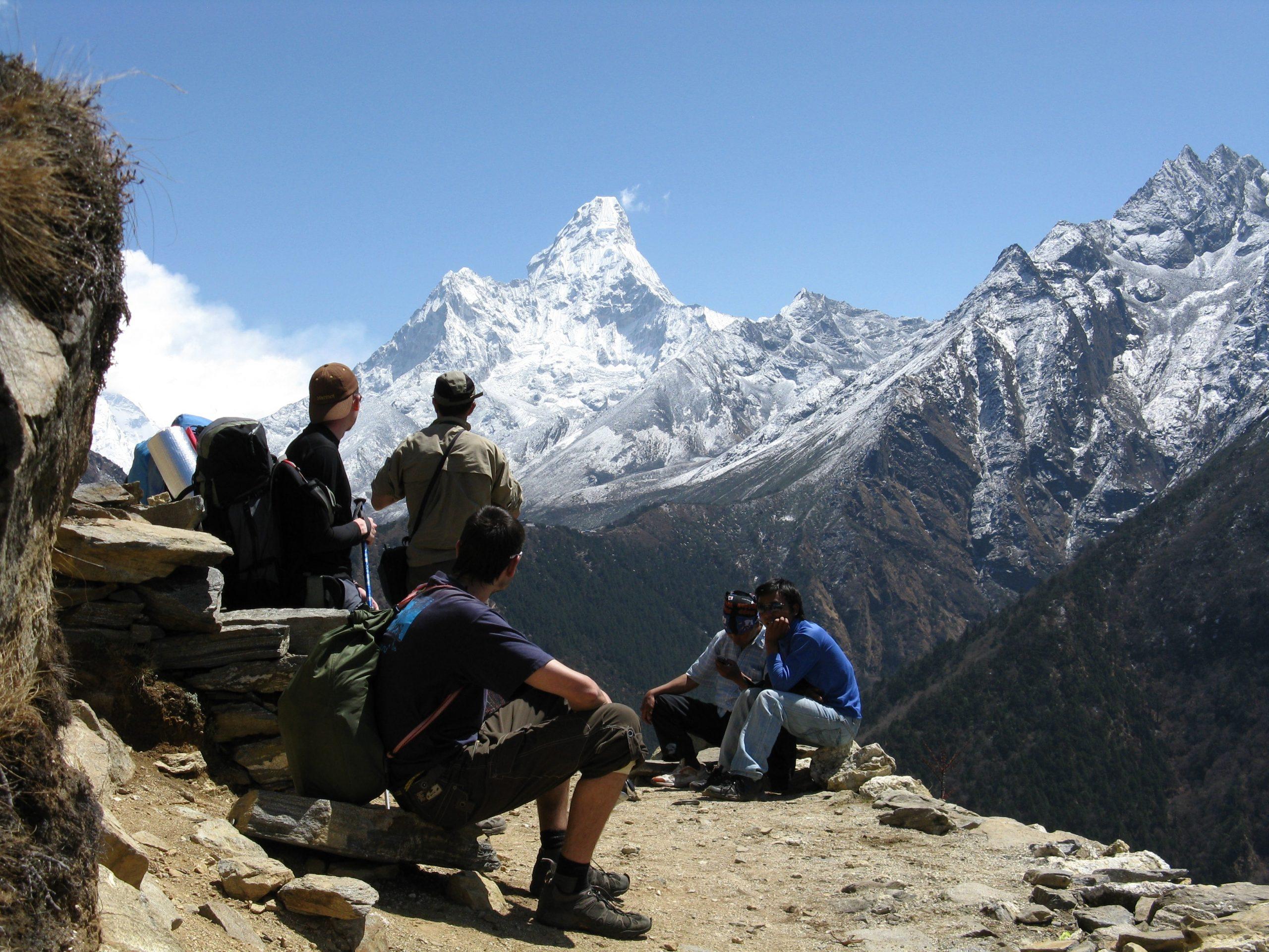 hikers taking a break on the trail following trail etiquette