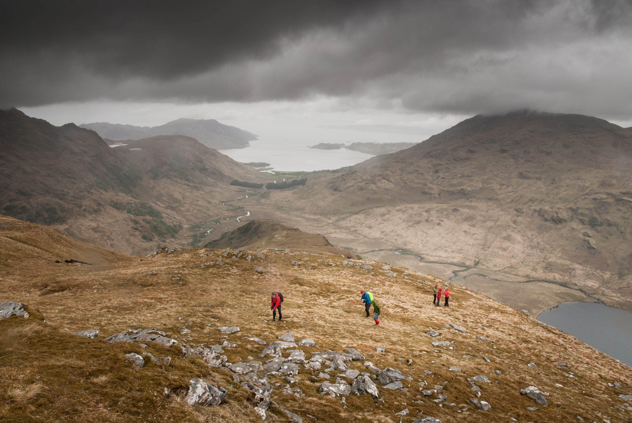 backpackers on mountain peak